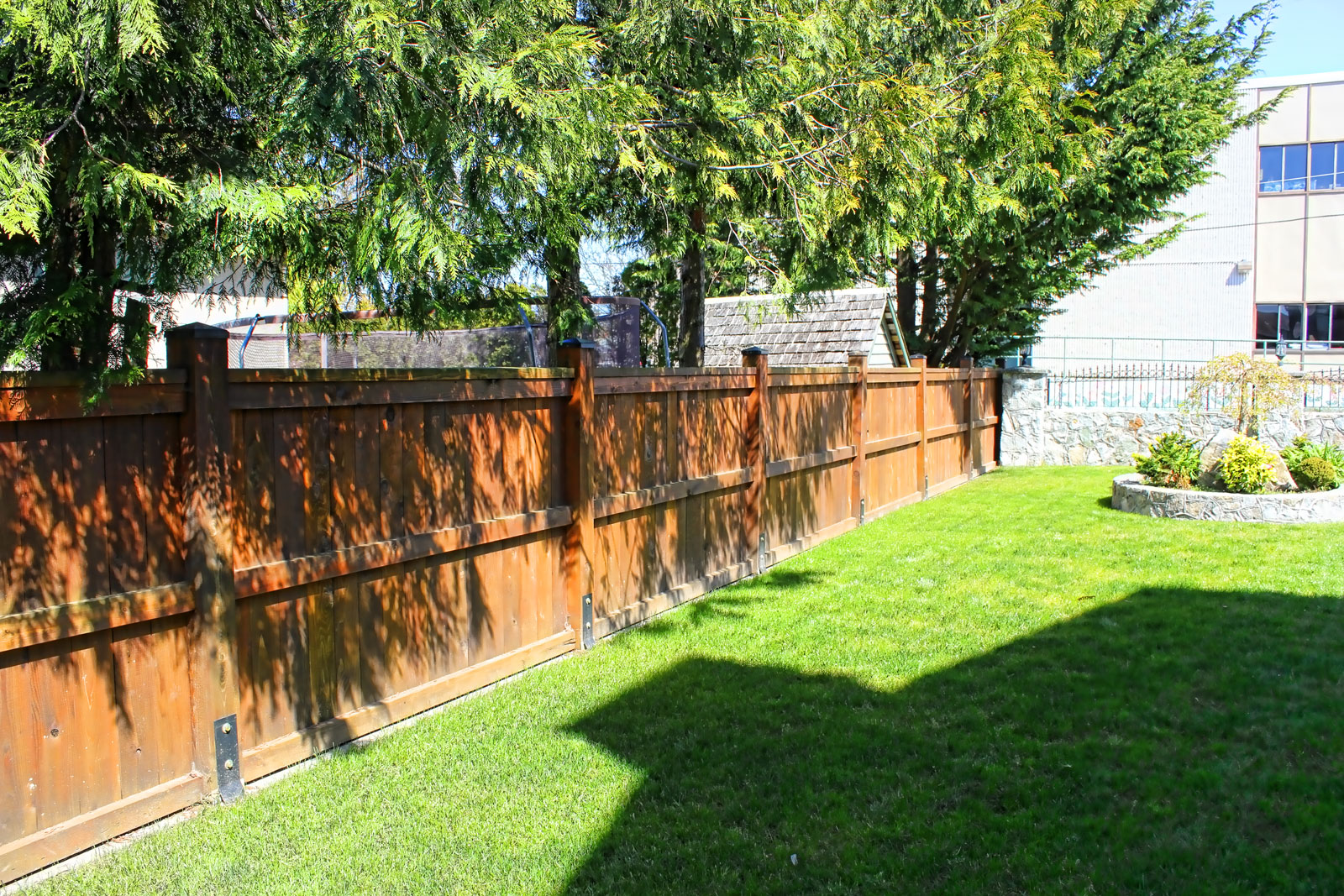 A fence abuts the stone wall